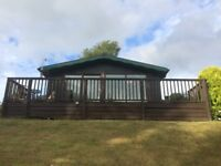 FOR SALE Log Cabin 75 year lease, 3 bedrooms, fantastic views, with or without furniture.
