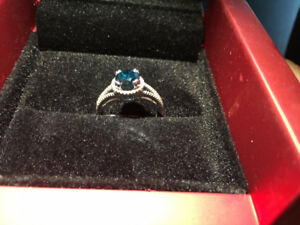 14kt white gold ring with blue diamond center stone