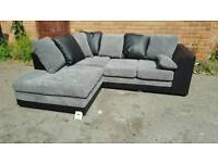 Lovely BRAND NEW black leather and grey jumbo cord corner sofa .any side.can deliver