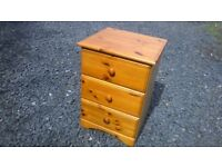 Solid pine three drawer bedside unit