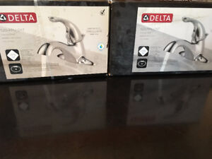 Two never used Delta 520 PPu DST bathroom faucets