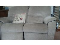 Reclining two seater sofa.