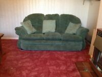 Comfortable three piece suite. Sofa and two chairs.