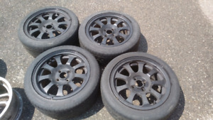 Black 15x7 4x100 aluminum rims with used tires