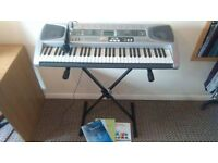 CASIO LK-55 KEYBOARD WITH KEY LIGHTING SYSTEM, Adjustable stand, Plug in microphone, 3 books.