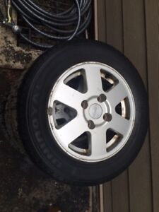 """14"""" Nissan rims and tires  185/65/14"""