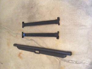 Mazda Tribute 2006  trunk cover and roof bars $75.00
