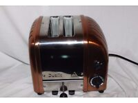 Boxed 2-slot Dualit Vario/Classic toaster in copper/ stainless steel/solid aluminium.