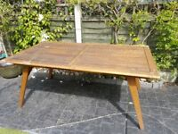 Extending hardwood patio table seats 10/12 comfortably