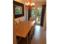 dining room table and 8 cream leather chairs