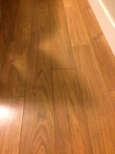 Cherry Wood Look Laminate - Approximately 500 square feet.