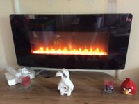 Electric wall mounted fire effect heater