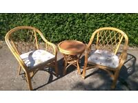 Conservatory set comprising 2 small wicker chairs and table