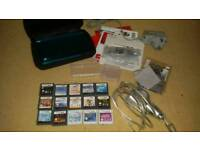 Blue 3ds in really good condition with 15 games 2 chargers carry case manuals and more