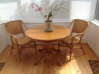 Victorian pedestal dining table and pair of whicker chairs