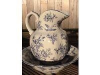 Vintage style decorative ceramic jug & bowl, with an off white glaze & blue decorative design.