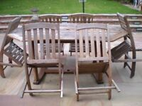 Wooden Garden Furniture Set comprising a table and 6 chairs. £40.