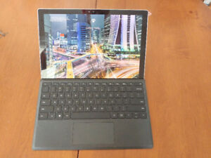 Microsoft Surface Pro 4, with type cover. i5, 4GB RAM 128GB SSD