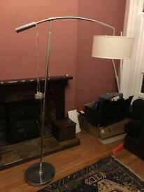 Tall floor standing chrome modern lamp