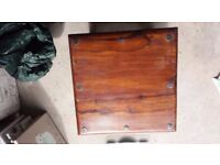Solid dark wood coffee table with stud detail