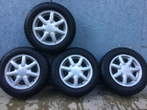 185/65r14 winter tires on 4 x100 VW alloy wheels.
