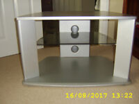 Silver tv stand with black glass shelf.
