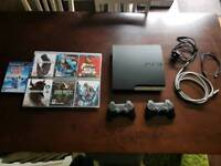 Playstation 3 PS3 250GB with 7 games, 2 controllers and leads