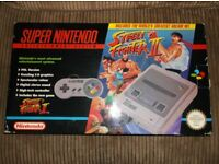 Boxed SNES Street Fighter II edition console complete, also 30 games, 4 unboxed.