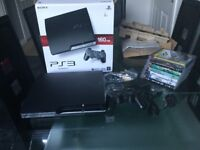 PS3 160gb boxed plus 7 games