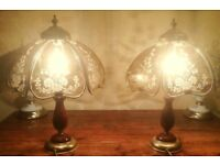 A pair of antique style brass and wood table lamps