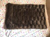 Brown faux fur covers
