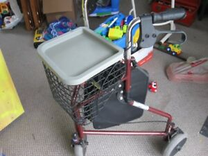 Three wheeled walker with basket
