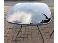 Metal Garden Table with glass top And 4 Chairs.