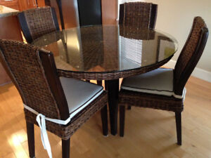 Rattan and Glass top dining table and four chairs