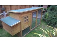 Wood chicken coop / rabbit hutch, felt roof, raised roost/nest box, dispensers inc