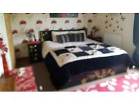 Super kingsize bed with cabinets and bedding