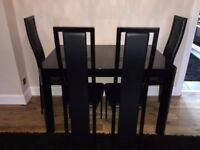 NOIR Black Glass Extendable Dining Table with 4 Chairs