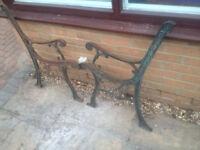 Cast iron garden bench ends.
