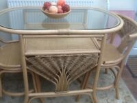 Lovely bistro set for two. Cane bistro set in good condition.
