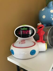 Elmo French English alarm clock/night light