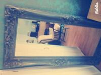 Very large bevelled mirror.