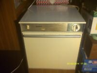 A VERY SMOOTH , QUIET TUMBLE CLOTHES DRYER , AN OLDER MODEL BUT WORKS VERY WELL ++