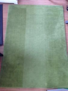 """IKEA Hellum GUC green rug. 4.5' x 6'5"""" feet"""