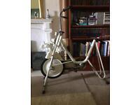 Exercise bike with wheel