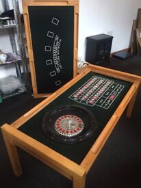 Beautiful wooden table with a hidden games / casino table