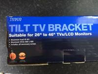 "Tv wall mount 26"" to 40"" TV tilt brand new"
