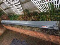 Pipe holder for roof rack - Truck Rax