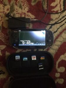 Playstation Vita w/ 5 Games and Case.