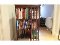 Vintage Bookcase which revolves for easy access. This is made of dark wood.