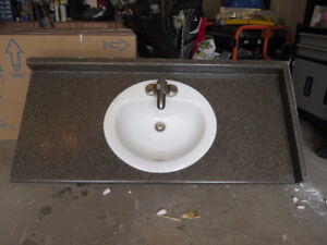 Countertop with sink and facet